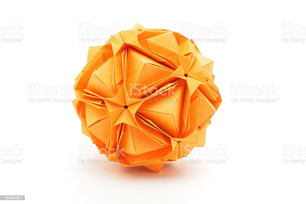 One orange origami polyhedron paper craft design stock photo