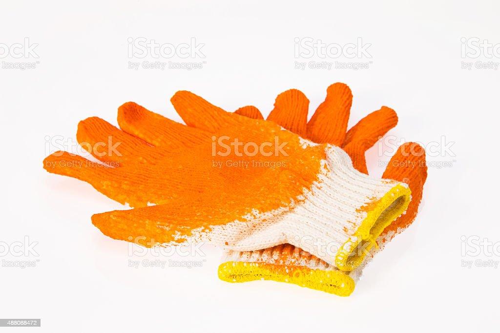 One pair of gloves orange stock photo