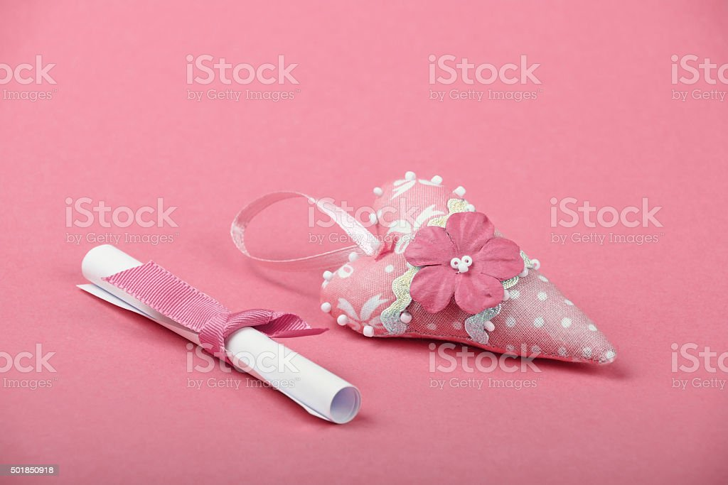 One paper message and heart on pink background royalty-free stock photo