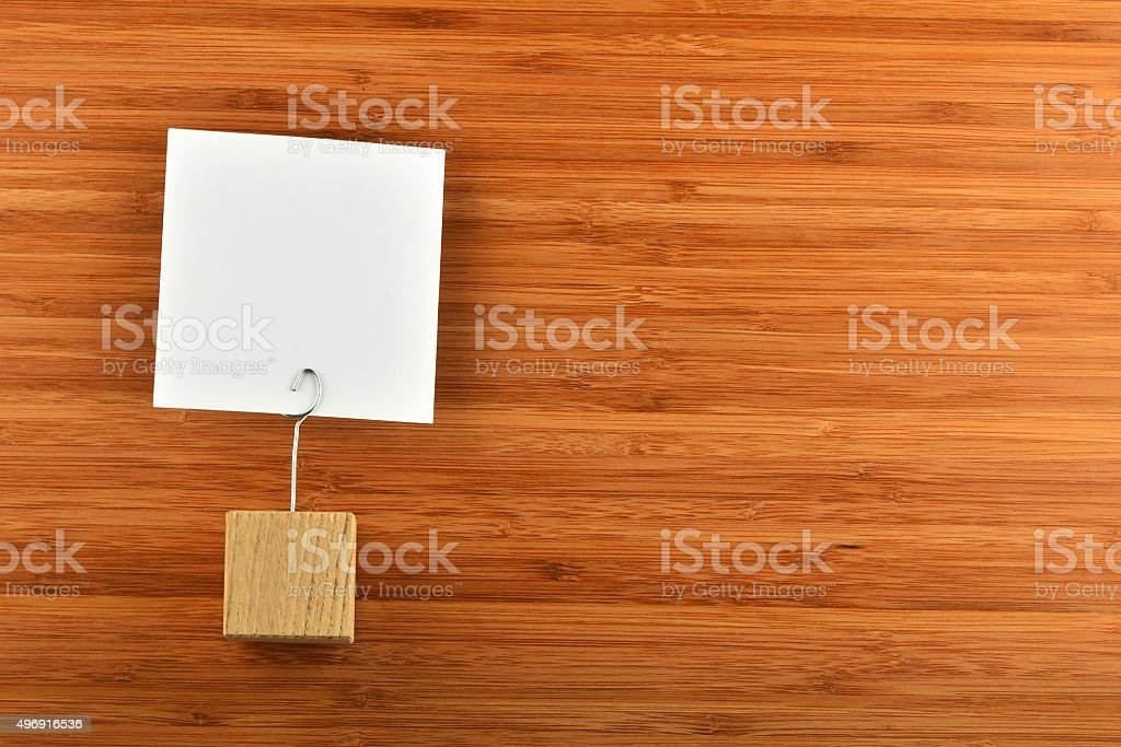 One paper note with holder on bamboo wooden background royalty-free stock photo