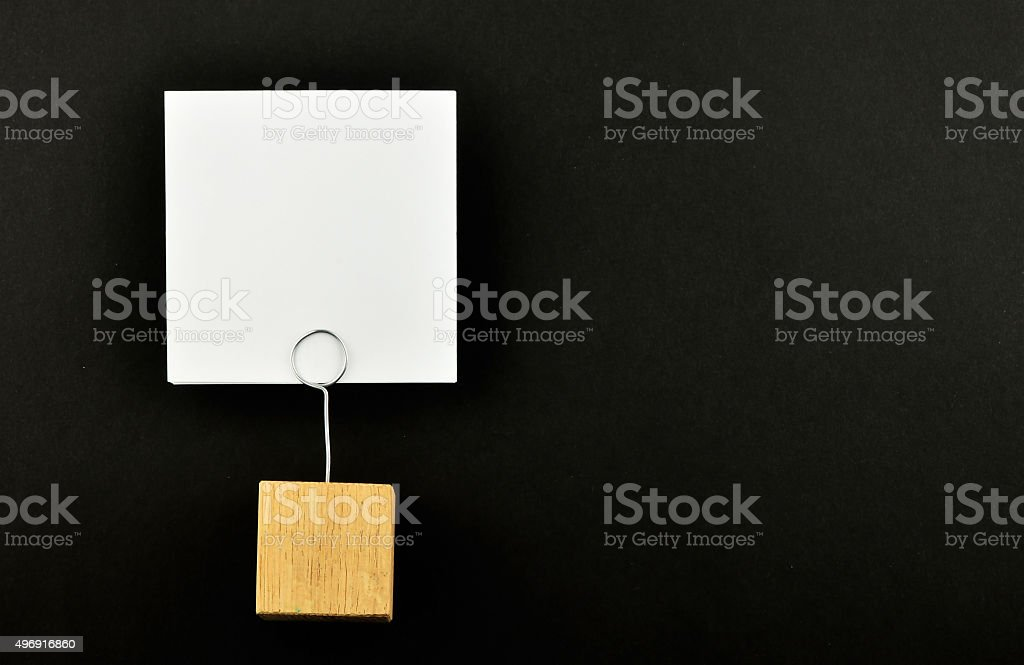 One paper note with holder on black background for presentation royalty-free stock photo