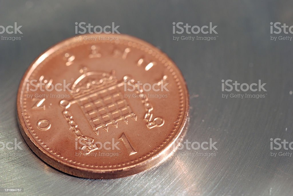 One penny coin on silver surface royalty-free stock photo