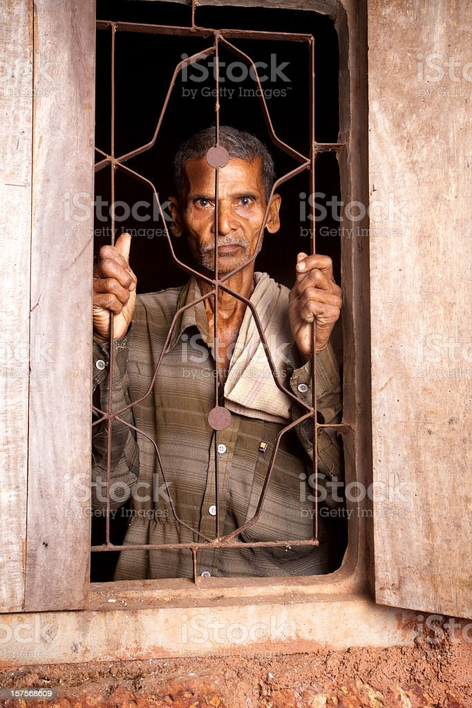 One Pensive Senior Rural Indian man looking from window royalty-free stock photo