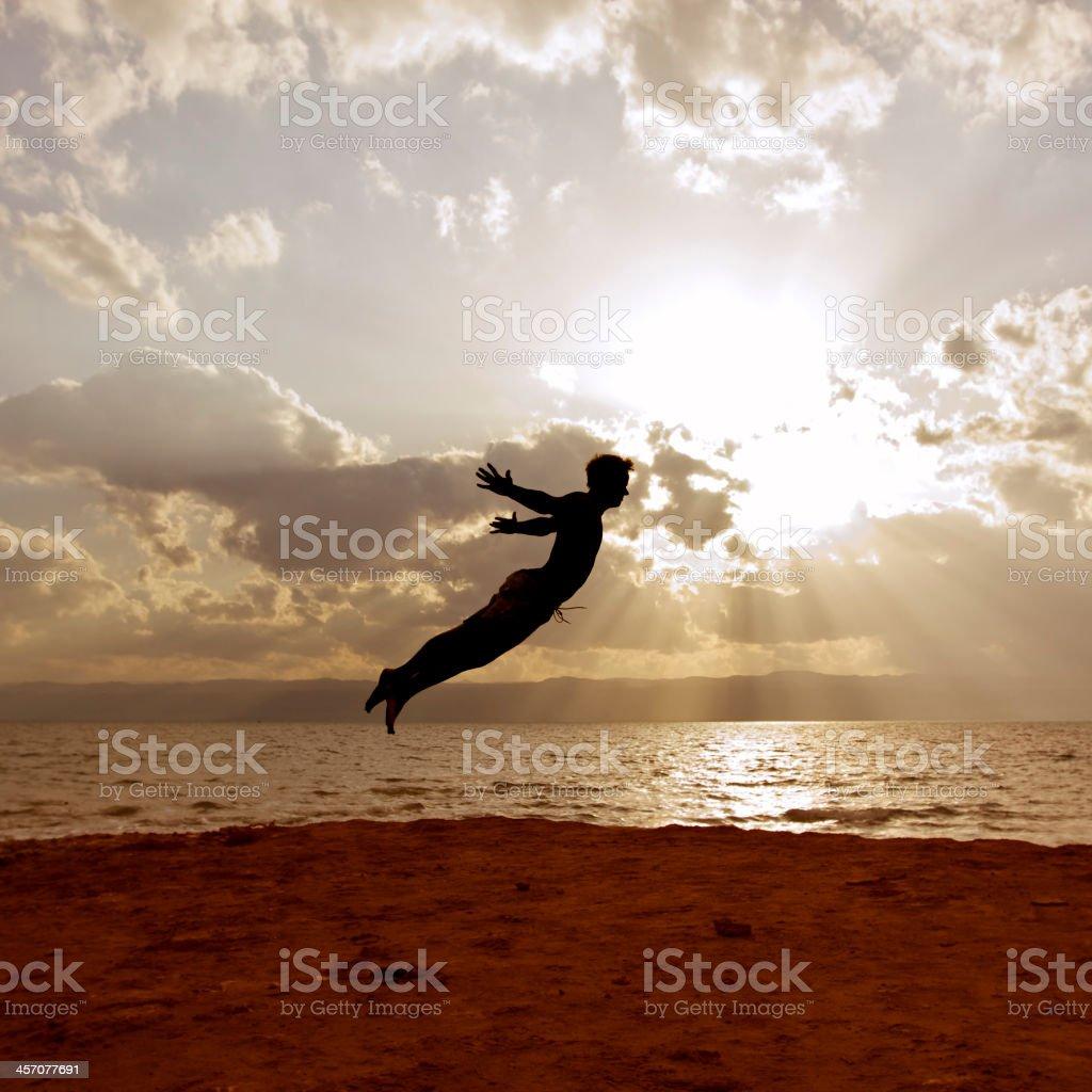 One person acrobatic jumping scene symbolize vitality, aspiration, success, progress stock photo