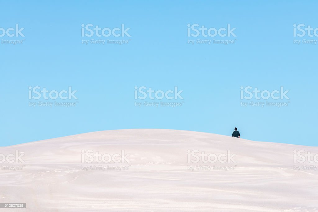 One person in the distance on a sand dune stock photo