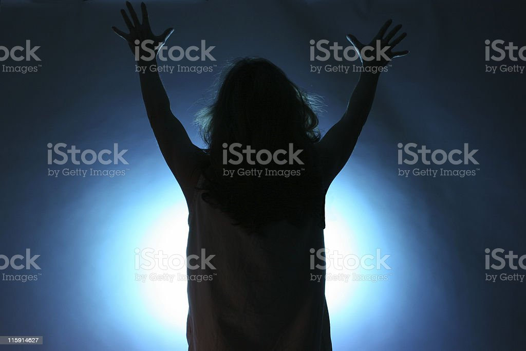 One person offering praise with uplifted hands royalty-free stock photo