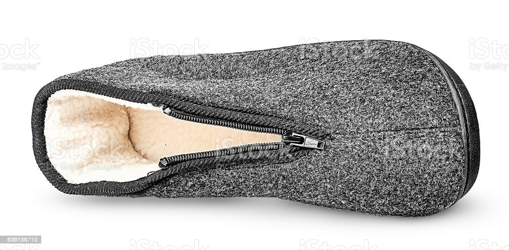 One piece comfortable dark gray slipper lying on the side stock photo