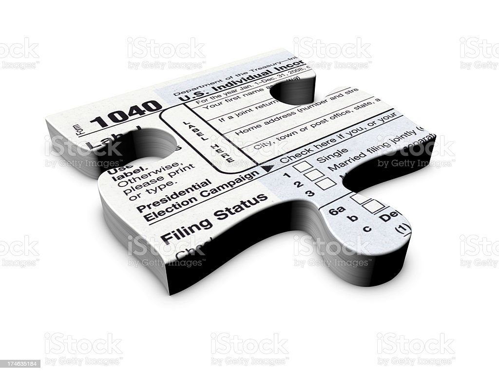 One Piece of the Income Tax Puzzle royalty-free stock photo