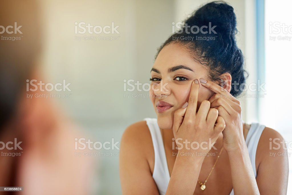 One pimple can change your entire day stock photo
