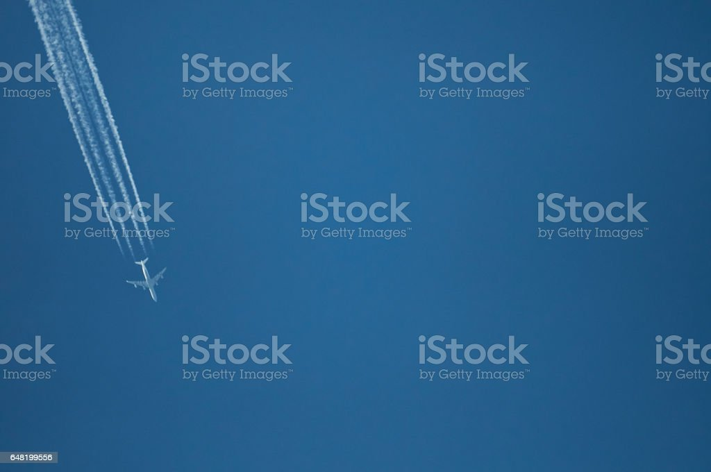 One plane fly on blue sky background stock photo