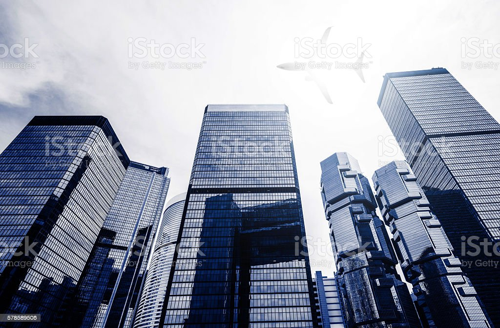 One Plane Fly on Business towers in HongKong stock photo