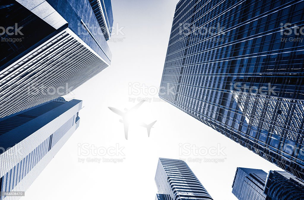 One Plane Fly on Business towers stock photo