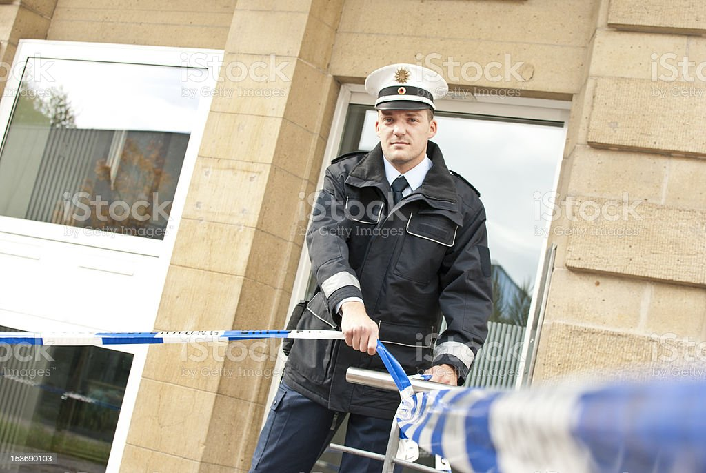 one police officer is cordon off an area stock photo