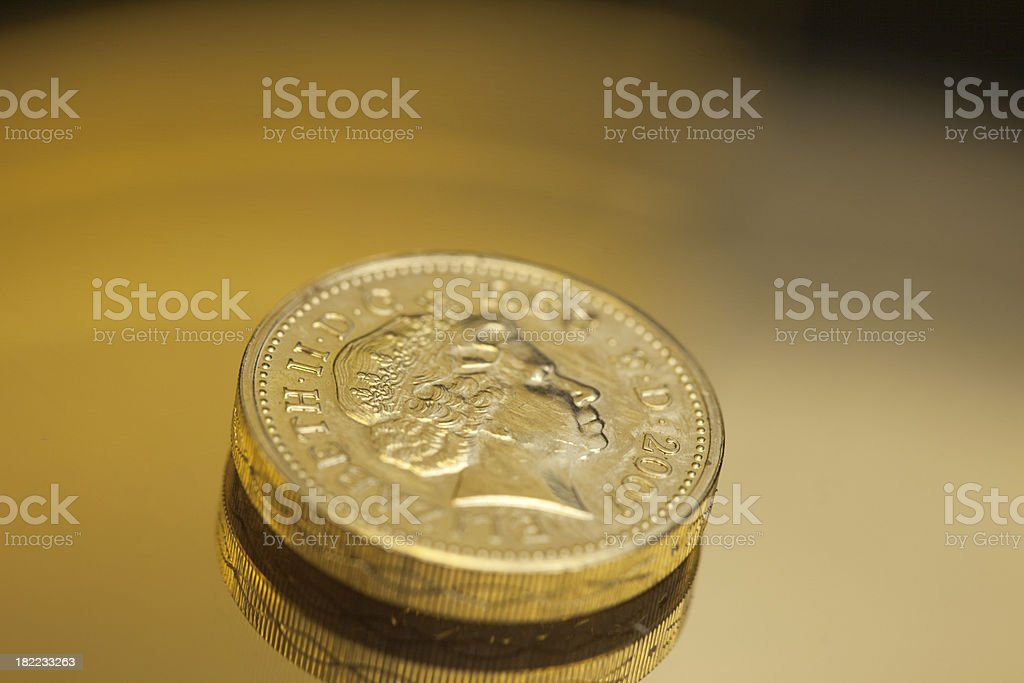 One Pound Coin On A Gold Reflective Background royalty-free stock photo