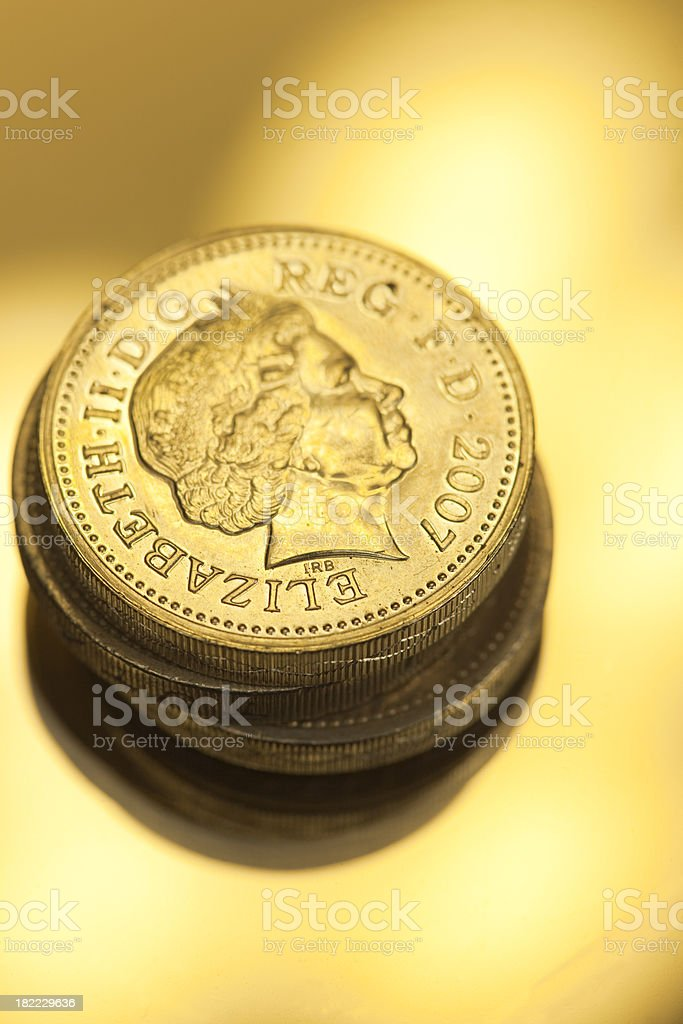 One Pound Coins In Gold royalty-free stock photo