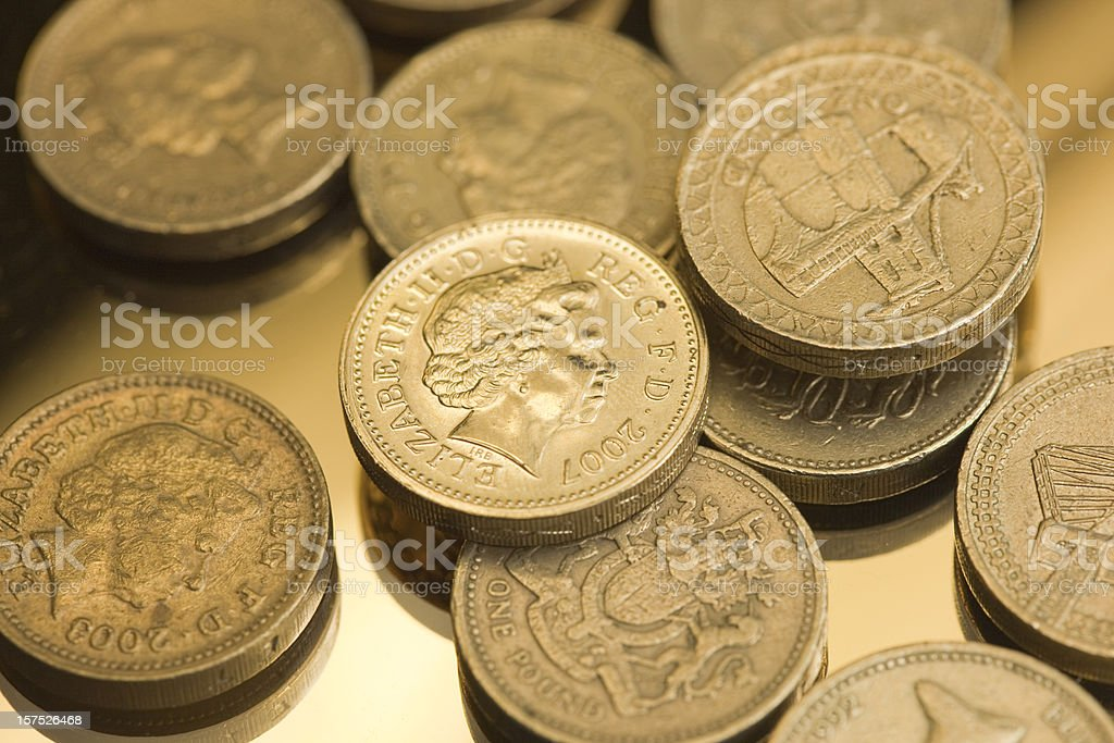 One Pound Coins On A Reflective Background stock photo