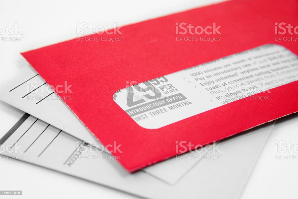 One red advertising envelope on top of two white ones royalty-free stock photo