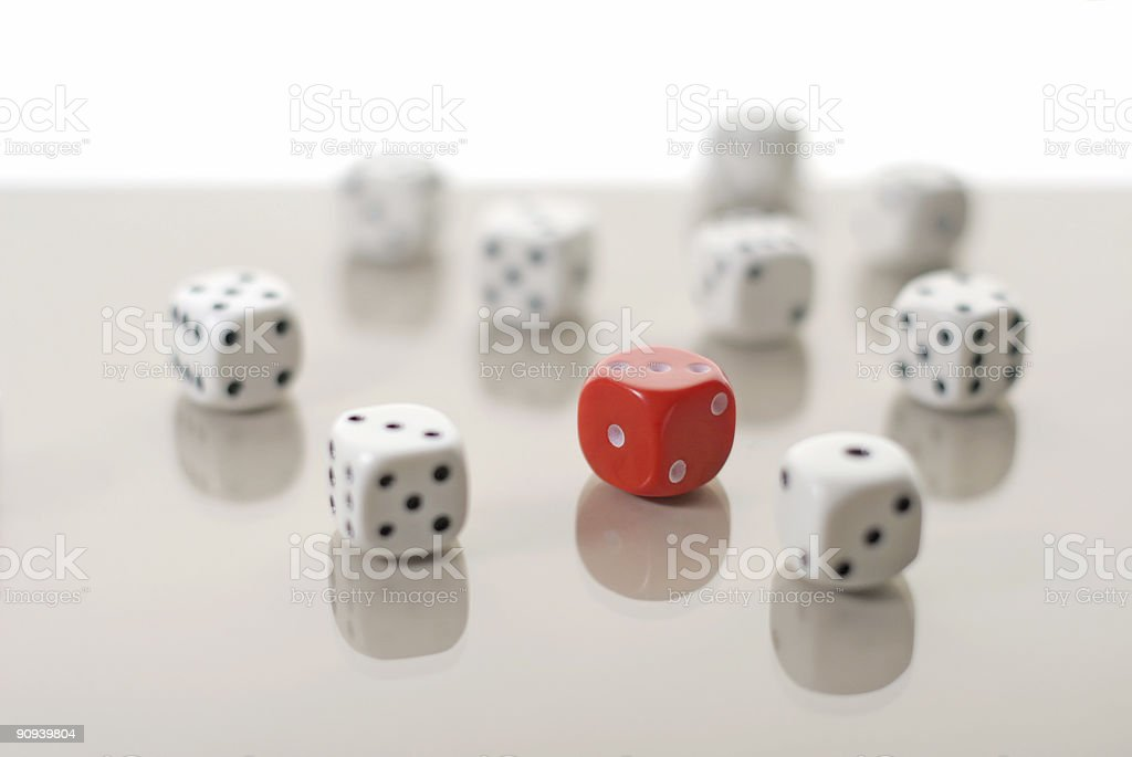One red dice among many white dices royalty-free stock photo