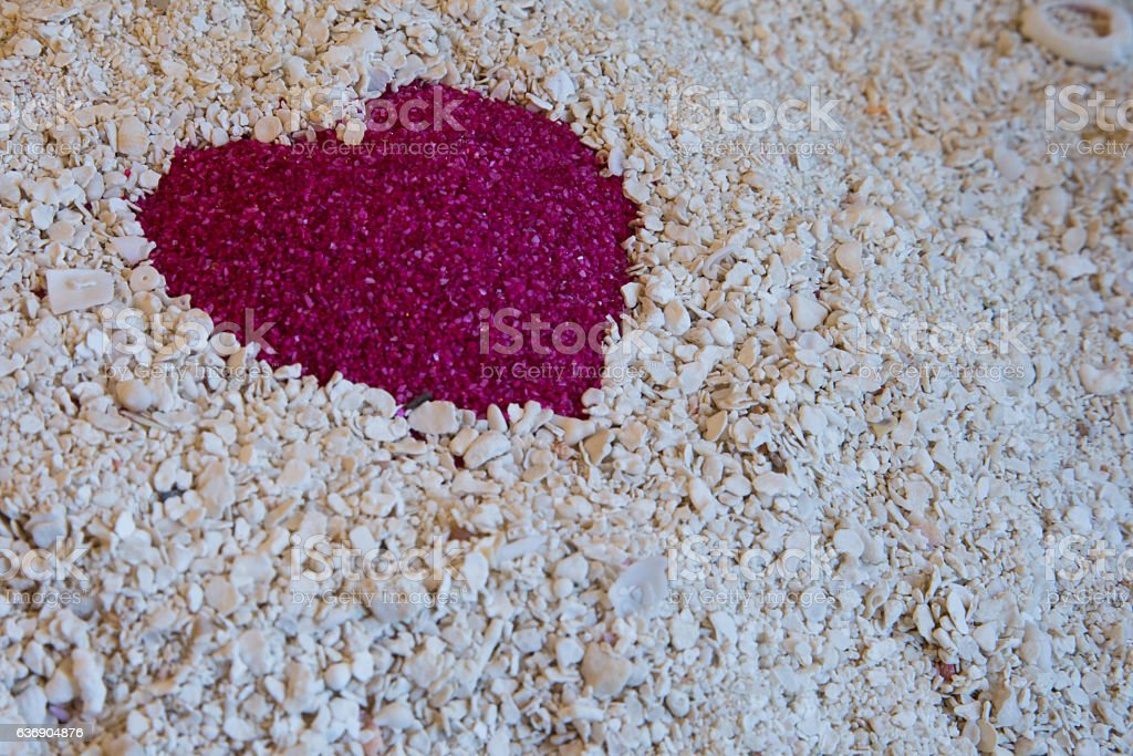 One Red Heart in the sand on the white sand stock photo