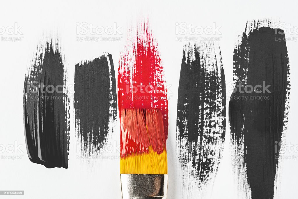 One red paint stroke among of grey stock photo