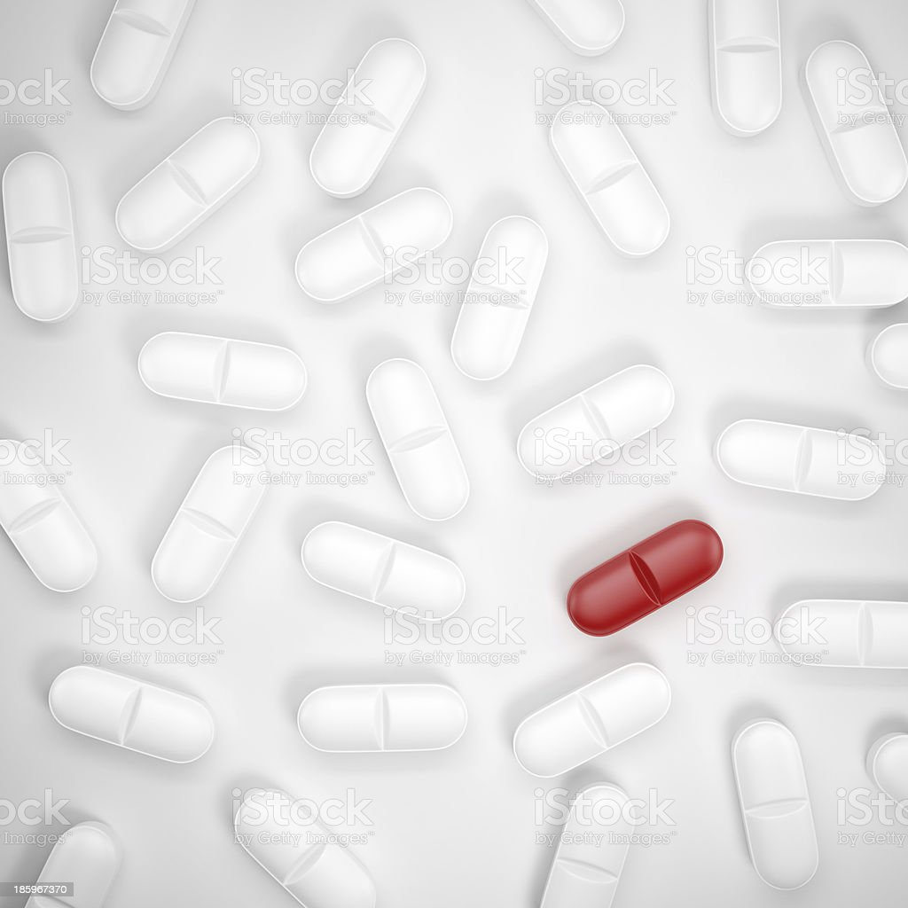 one red pill among grey pills royalty-free stock photo