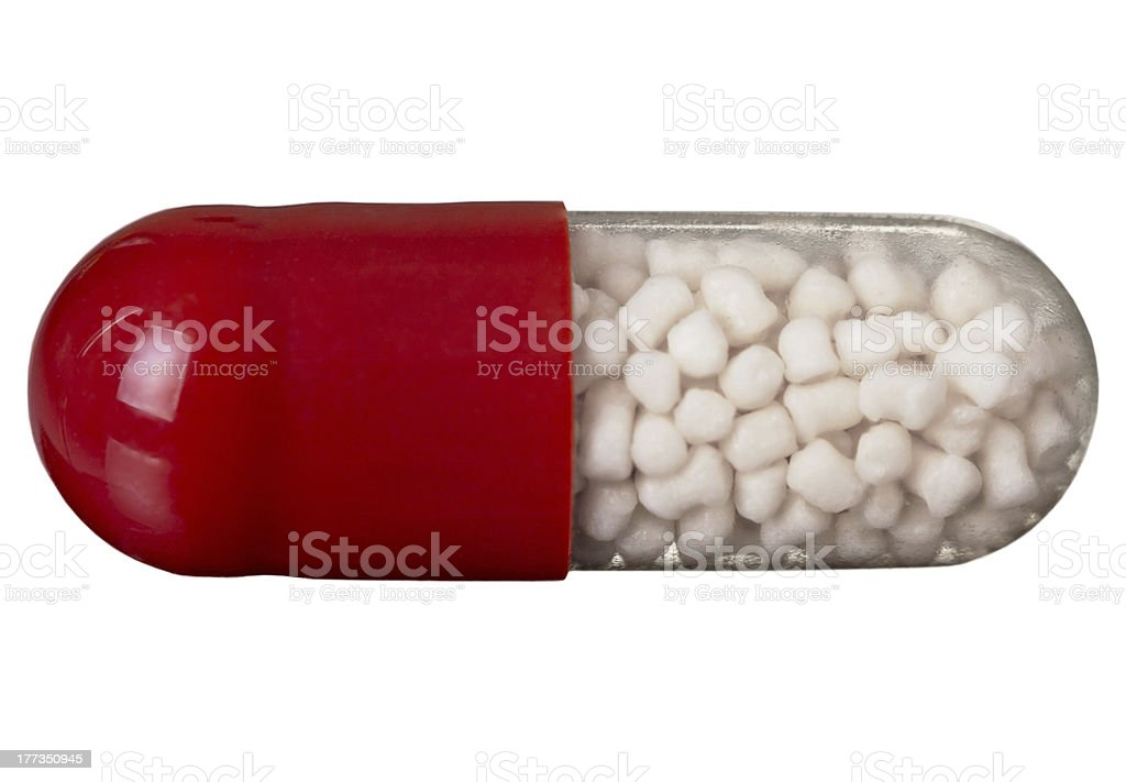 One red pill isolated on white royalty-free stock photo
