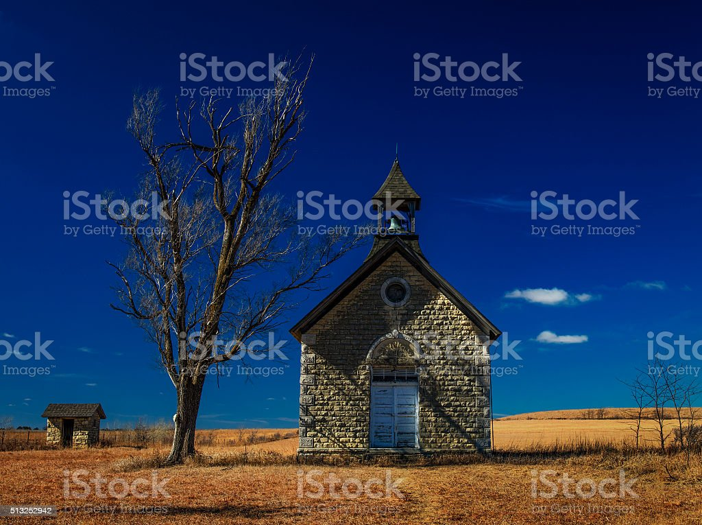 One Room School House in the Flinthills of Kansas stock photo
