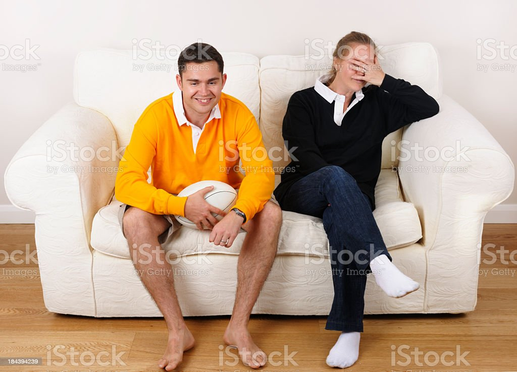 One Rugby Fan Smiles At Result While Another Agonises stock photo