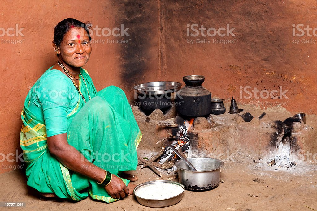 One Rural Indian Woman cooking food in the Kitchen royalty-free stock photo