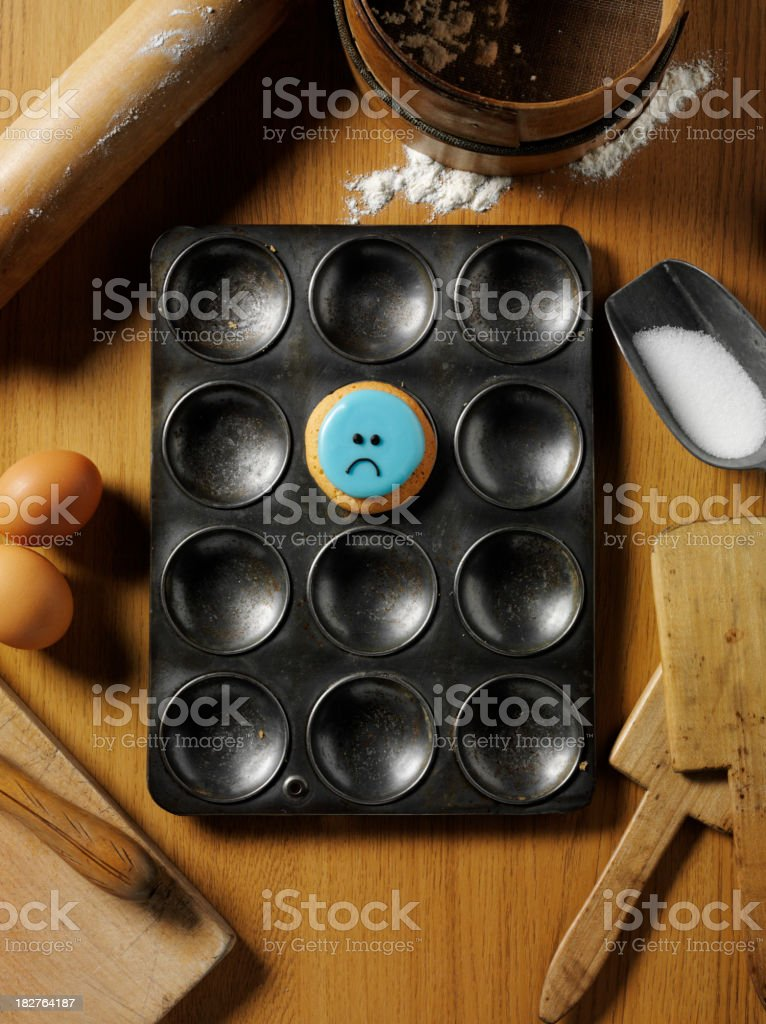 One Sad Cupcake in a Baking Tray royalty-free stock photo