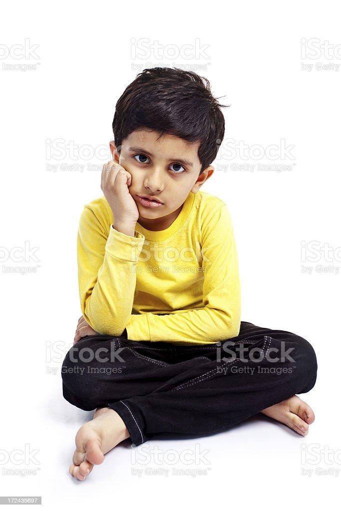 One Sad Indian Boy Child Isolated on White Full Length royalty-free stock photo