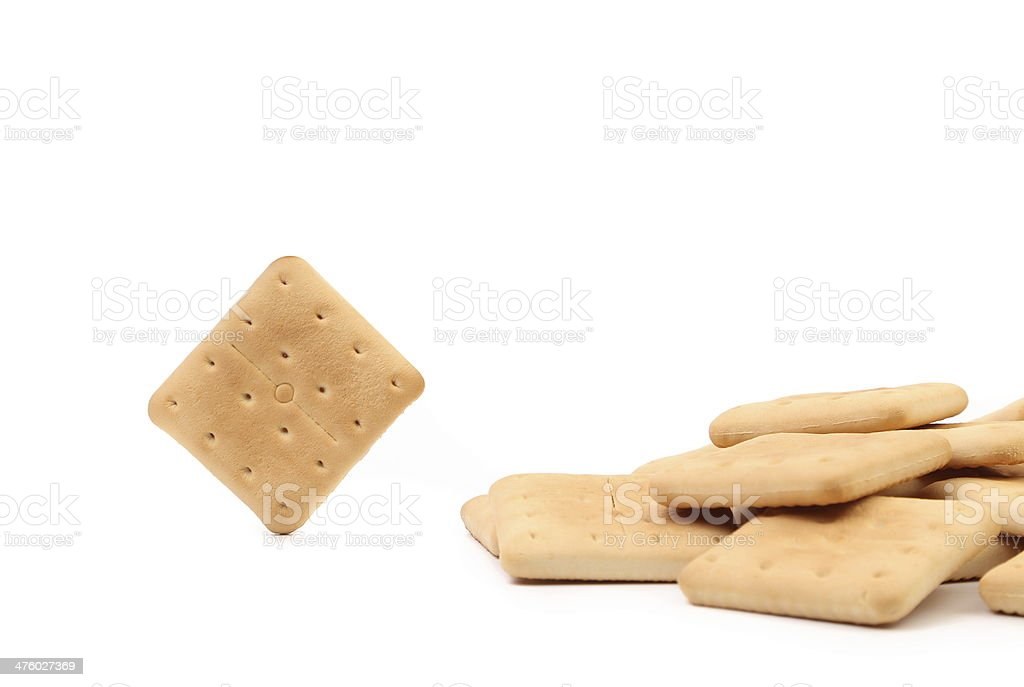 One saltine soda cracker and several. royalty-free stock photo