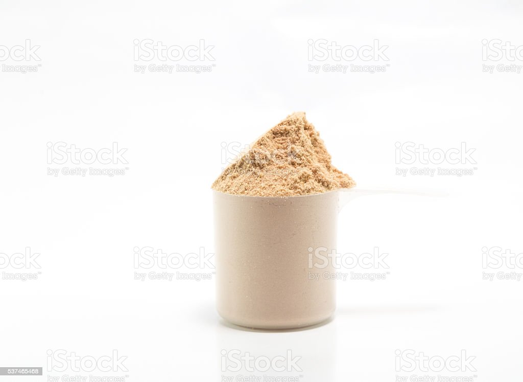One scoop of concentrate chocolate whey protein stock photo