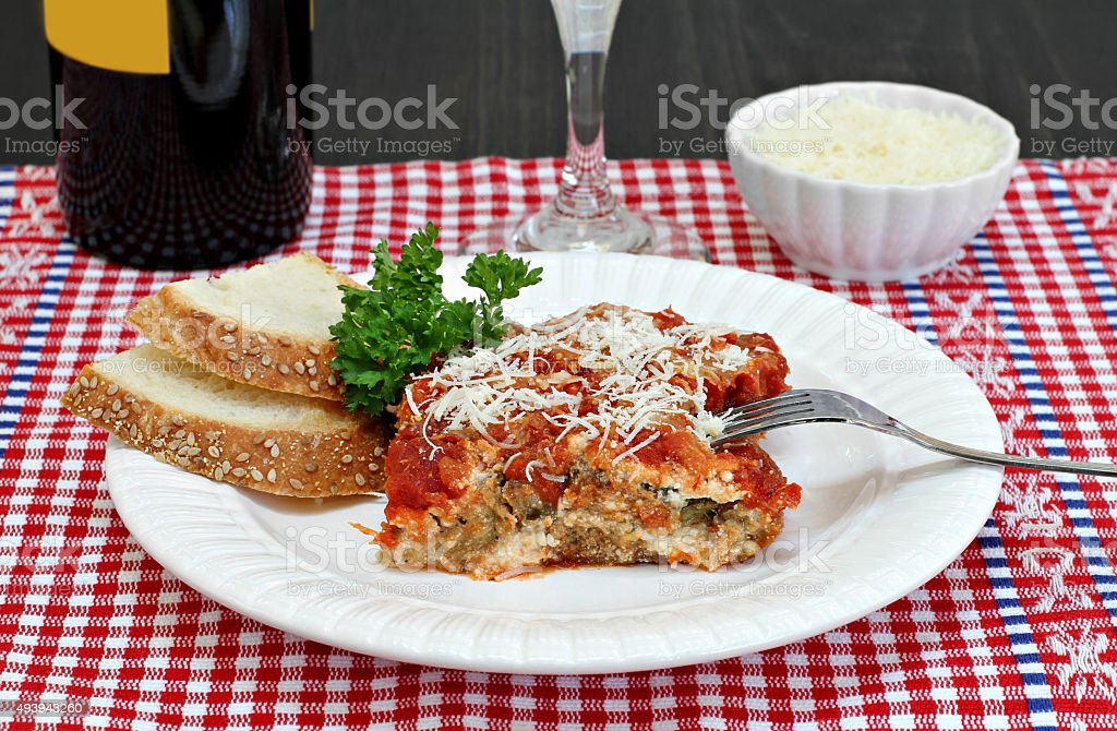 One serving of eggplant parmesan. stock photo