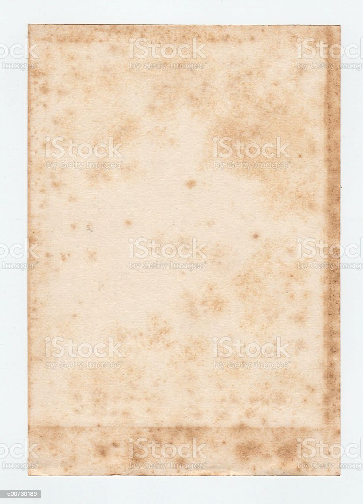 one sheet of aged photo album paper with foxing stock photo