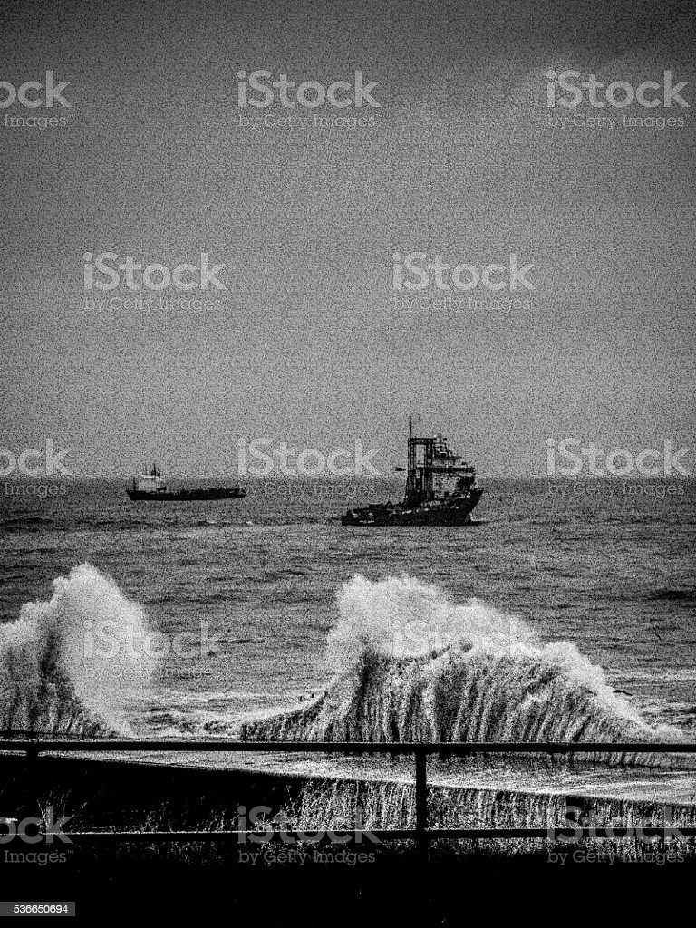 One Ship Beyond Big Waves During Storm stock photo