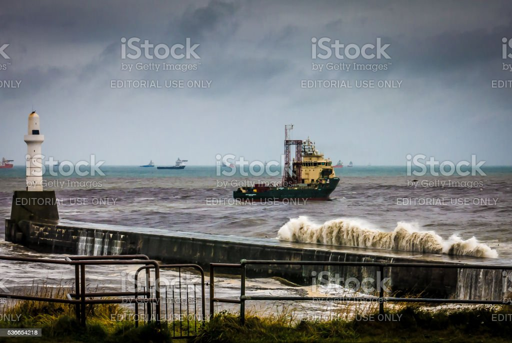 One Ship Near Aberdeen Lighthouse During Storm stock photo