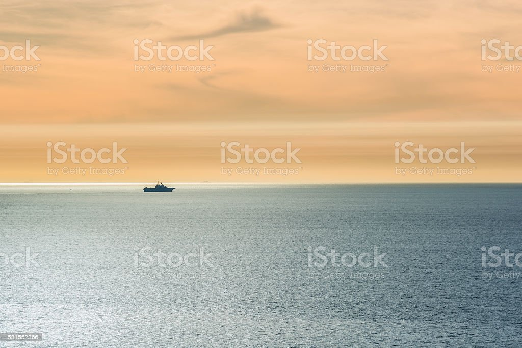 One ship sailing in the pacific ocean during sunset stock photo