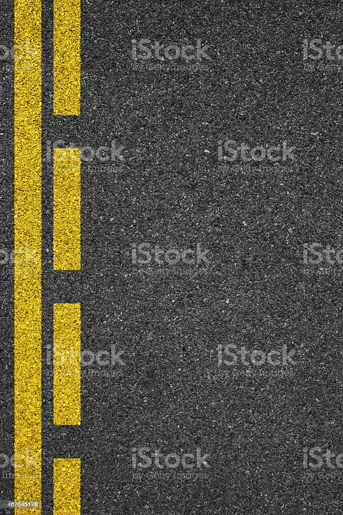 One side of an asphalt road with a yellow line stock photo