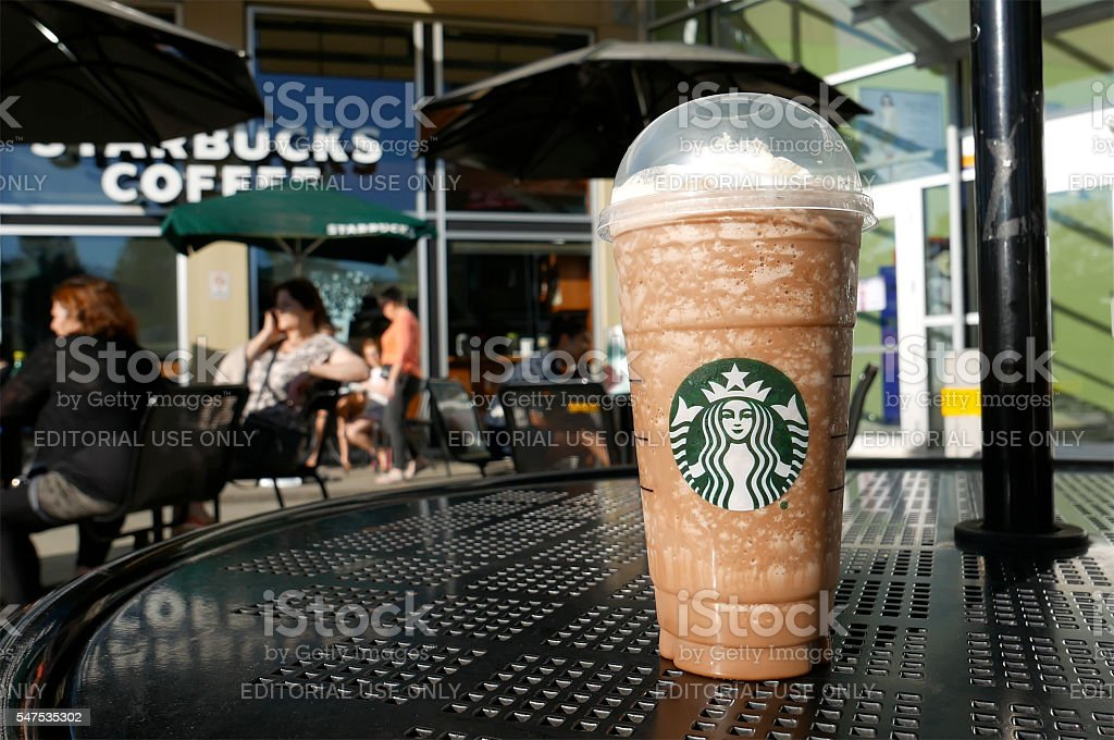 One side of people drinking Starbucks coffee stock photo