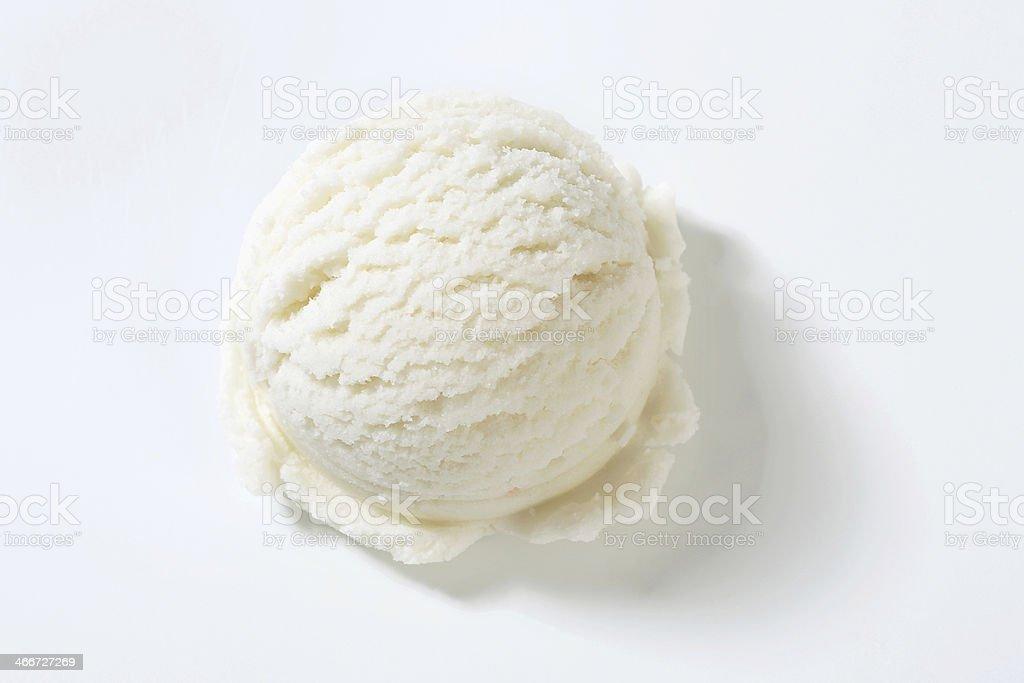One single lemon ice cream scooped onto a plain background stock photo