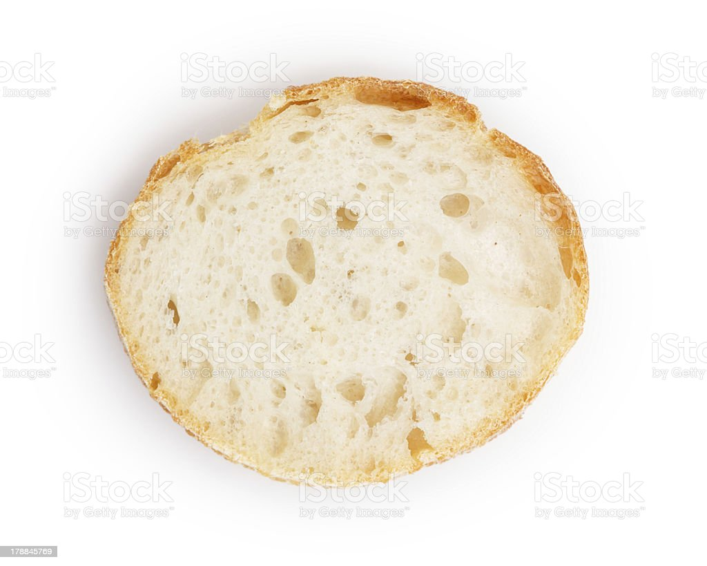 One slice of a French baguette stock photo