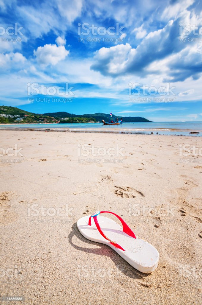 One Slipper on Summer Beach with White Sand royalty-free stock photo