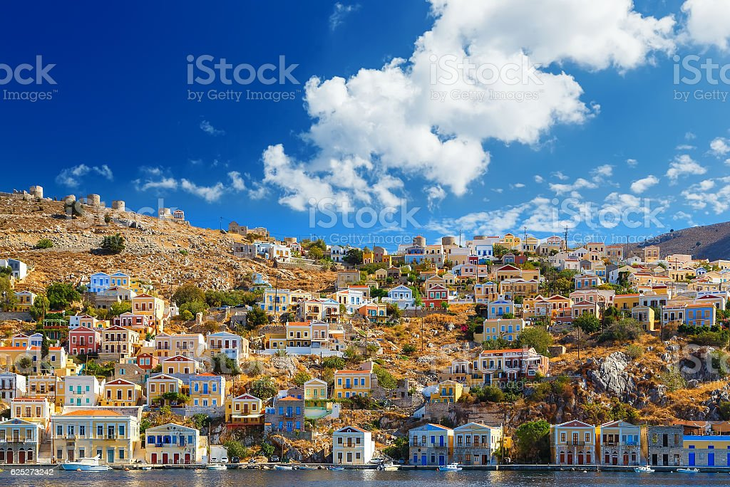 One small and pretty island Simi with his colourful buildings stock photo
