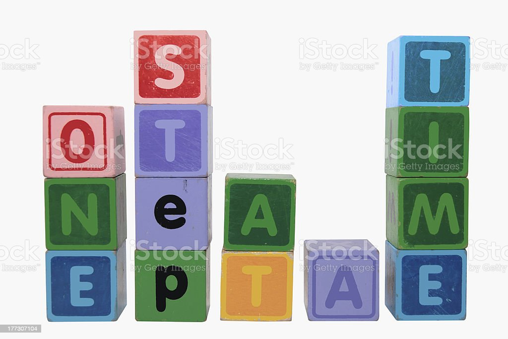 one step at a time in toy blocks stock photo