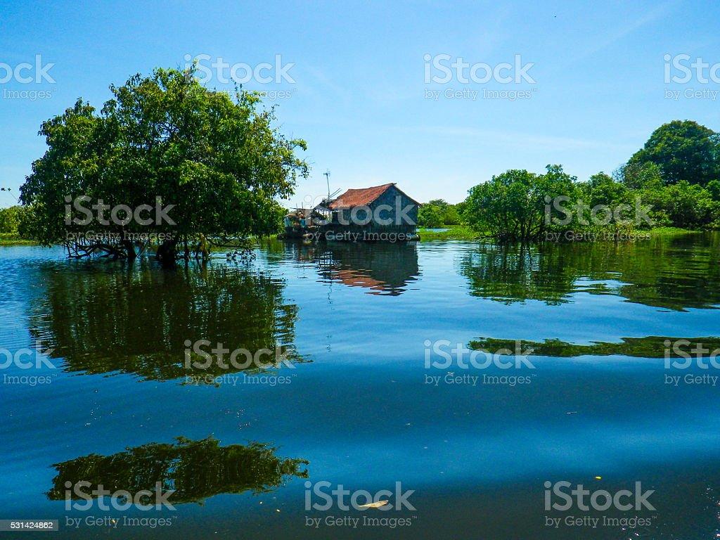 One Stilt House Standing on Tonle Sap Lake, Cambodia stock photo