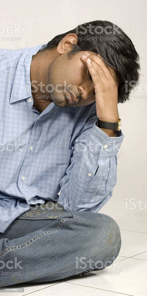 one stressed young man of indian ethnicity royalty-free stock photo