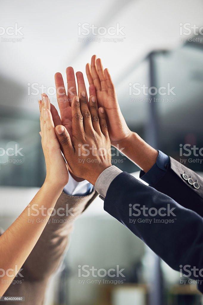 One team working towards one dream stock photo