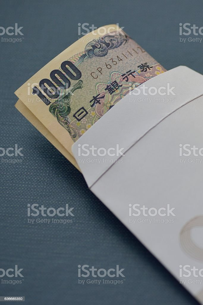 One thousand yen bill in gift envelope. stock photo