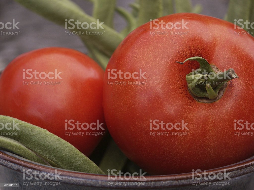 One tomato, two tomatoes... and fresh picked beans royalty-free stock photo